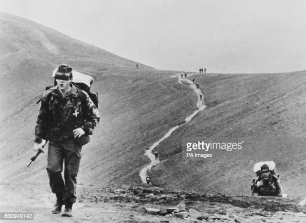SAS recruits climb to a rendez vous point high in the Brecon Beacons in an endurance march covering 90kms over 75 hours