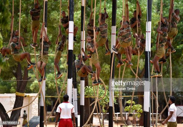 Recruits climbing vertical ropes during the training session at Parachute Regiment Training Centre on August 18 2017 in Bengaluru India Members of...