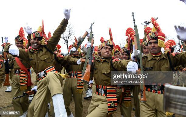 Recruits from the Indian Border Security Force dance after a passing out parade at BSF headquarter in Srinagar on March 8 2017 Some 126 new recruits...
