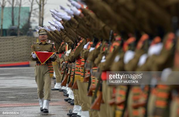 Recruits from the Indian Border Security Force take an oath during a passing out parade at BSF headquarter in Srinagar on March 8 2017 Some 126 new...