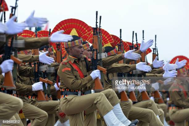Recruits from the Indian Border Security Force take part in a passing out parade at BSF headquarter in Srinagar on March 8 2017 Some 126 new recruits...