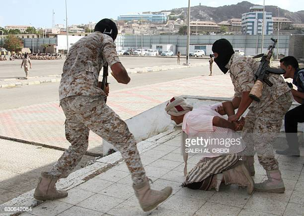 Recruits from the Yemeni counterterrorism forces show their skills during a graduation ceremony on December 29 in the southern city of Aden / AFP /...