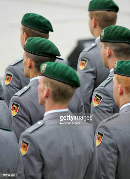 Recruits of the German armed forces Bundeswehr are seen during a swearing in ceremony at the courtyard of the Bendler Block the former German army's...