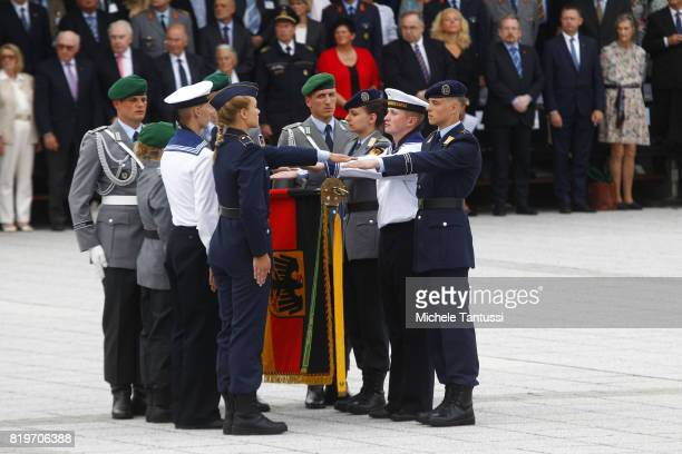 Recruits of the German armed forces Bundeswehr take part in a swearing in ceremony in the courtyard of the former German army's headquarters now...