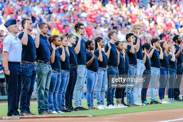 Recruits take the pledge to enter the United States Air Force before the game between the Texas Rangers and the Boston Red Sox on July 04 2017 at...
