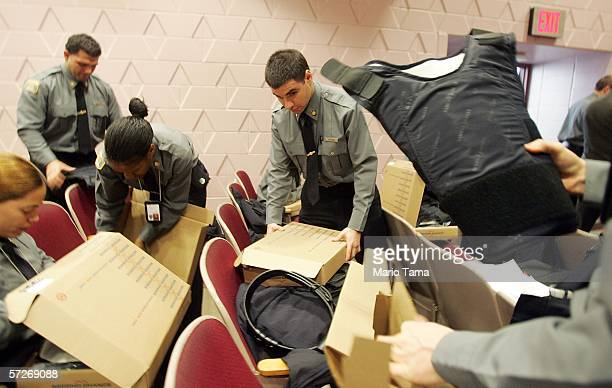 Recruits unpack their bulletproof vests at the New York City Police Academy April 6 2006 in New York City Recruits are trained in firearms and...