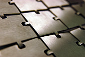 Rectangular pieces of metal decoratively linked together