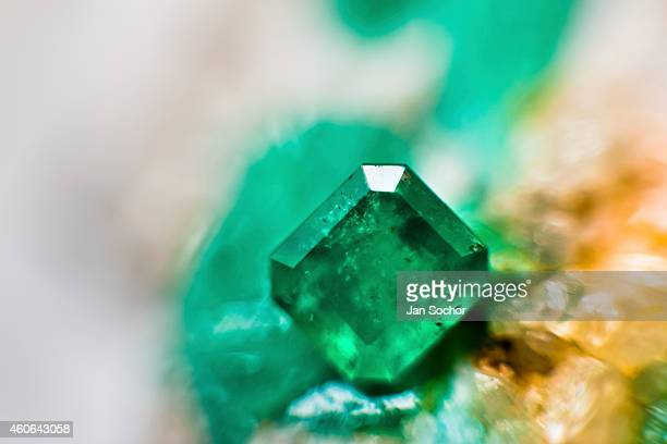 A rectangularshaped emerald is seen in a jewelry workshop on February 08 2014 in Bogota Colombia Around 60% of the world's emerald production come...