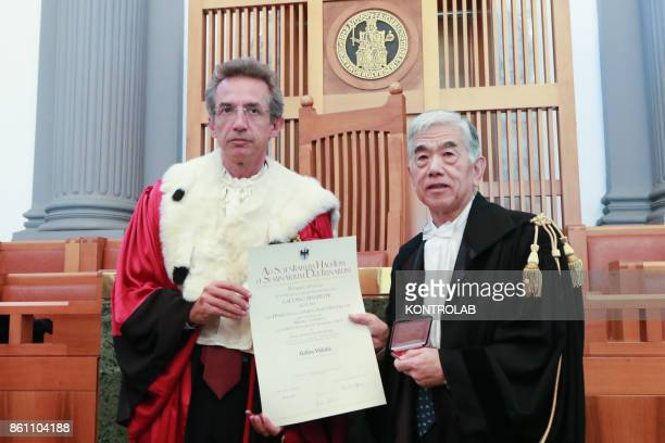 Rector Gaetano manfredi gives an Honoris Causa Master degree in Engineering to Toray Industries inc's CEO Akihiro Nikkakuduring a ceremony in the...
