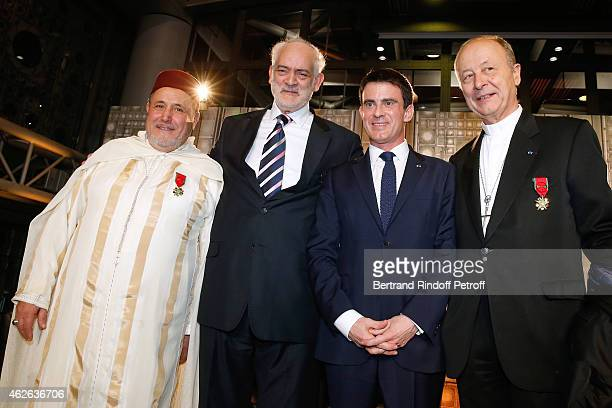 Rector of the Mosque of Evry awarded Khalil Merroun Rabbi of Ris Orangis awarded Michel Serfaty French Prime Minister Manuel Valls and Bishop of Evry...