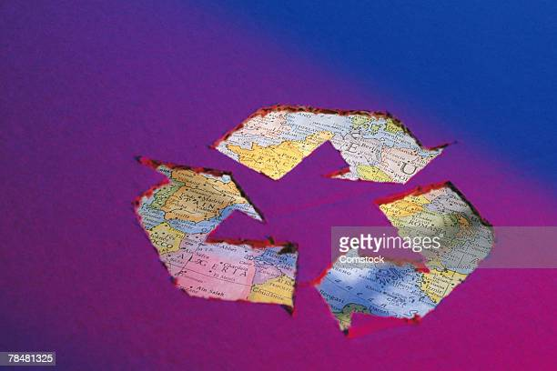 Recycle graphic , overlaid with map of world