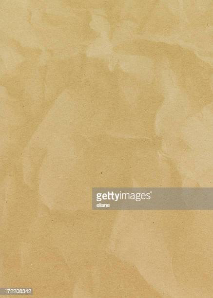 Recycled paper background covered by digital rainbow