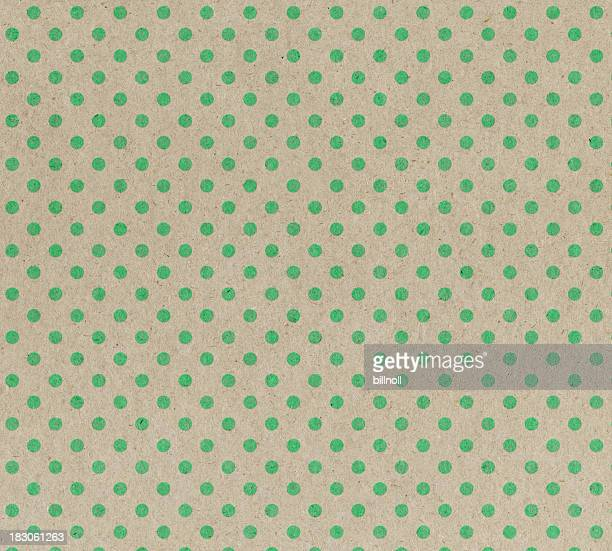 recycled paper with green dots