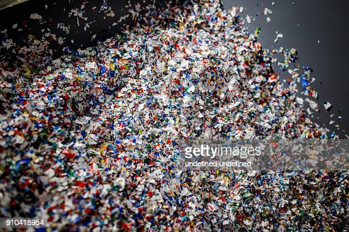 recycled plastic bottles and waste at the plant : Stock Photo