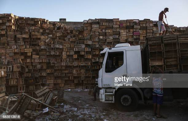A recycler loads a truck with recycled crates on May 15 2017 in Rio de Janeiro Brazil Brazil's economy remains in a deep recession