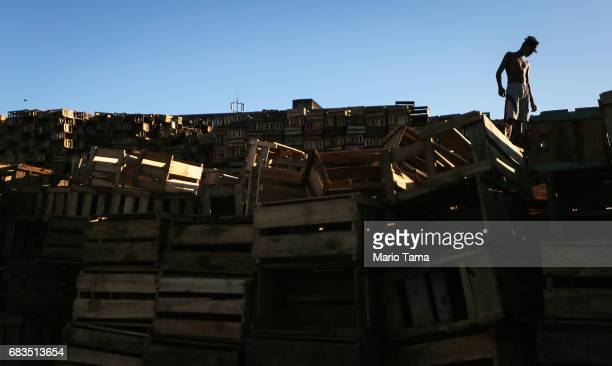 A recycler prepares to load a truck with recycled crates on May 15 2017 in Rio de Janeiro Brazil Brazil's economy remains in a deep recession