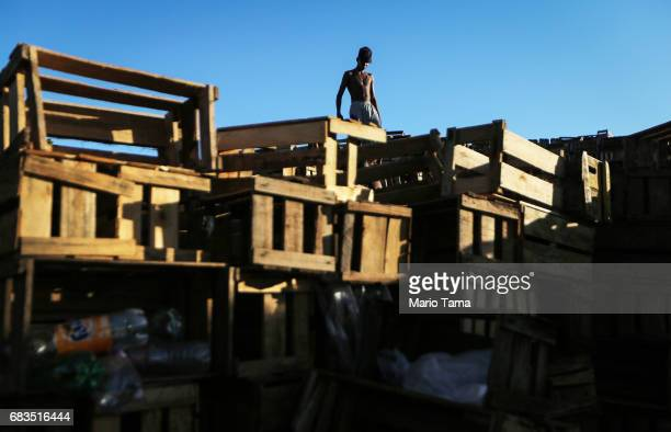 A recycler waits to load a truck with recycled crates on May 15 2017 in Rio de Janeiro Brazil Brazil's economy remains in a deep recession