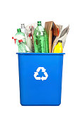 """""""A recycling bin with plastic bottles, paper, cardboard and other plastic items isolated on white."""""""