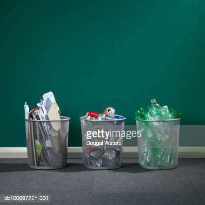 Recycling bins with paper, tin cans and plastic : Stock Photo