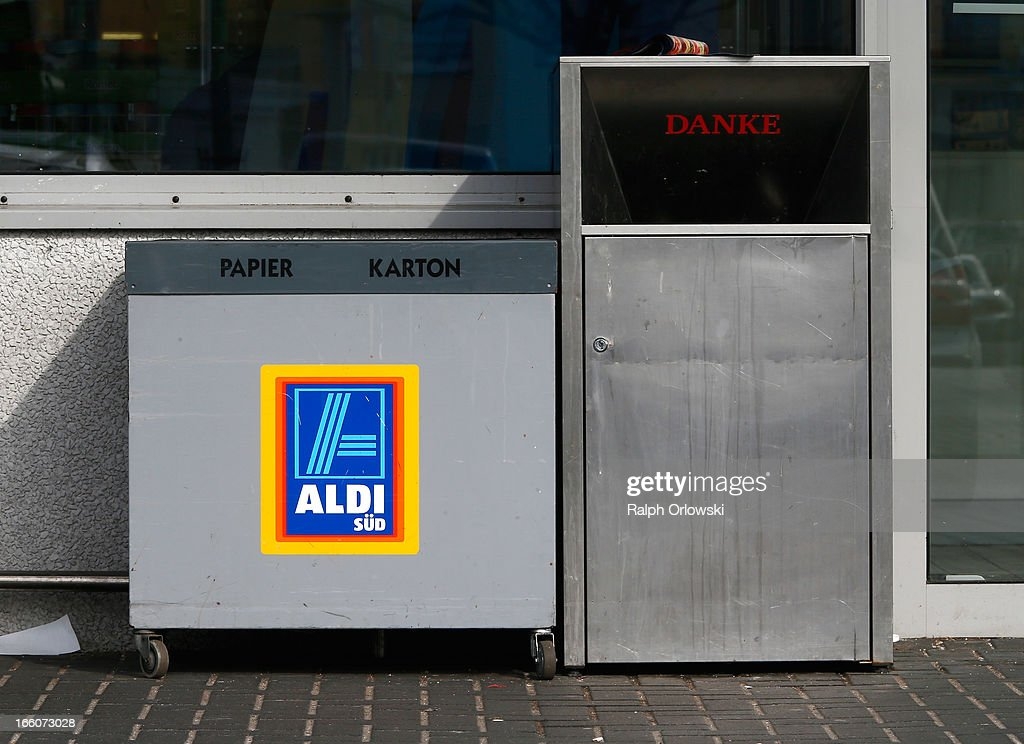 Recycling boxes stand next to the entrance of an Aldi store on April 8, 2013 in Ruesselsheim near Frankfurt, Germany. Aldi, which today is among the world's most successful discount grocery store chains, will soon mark its 100th anniversary and traces its history back to Karl Albrecht, who began selling baked goods in Essen on April 10, 1913 and founded the Aldi name by shortening the phrase Albrecht Discount. His sons Karl Jr. and Theo expanded the chain dramatically, creating 300 stores by 1960 divided between northern and southern Germany, with Aldi Nord and Aldi Sued, respectively. Today the two chains have approximately 4,300 stores nationwide and have also expanded into other countries across Europe and the USA. Aldi Nord operates in the USA under the name Trader Joe's.