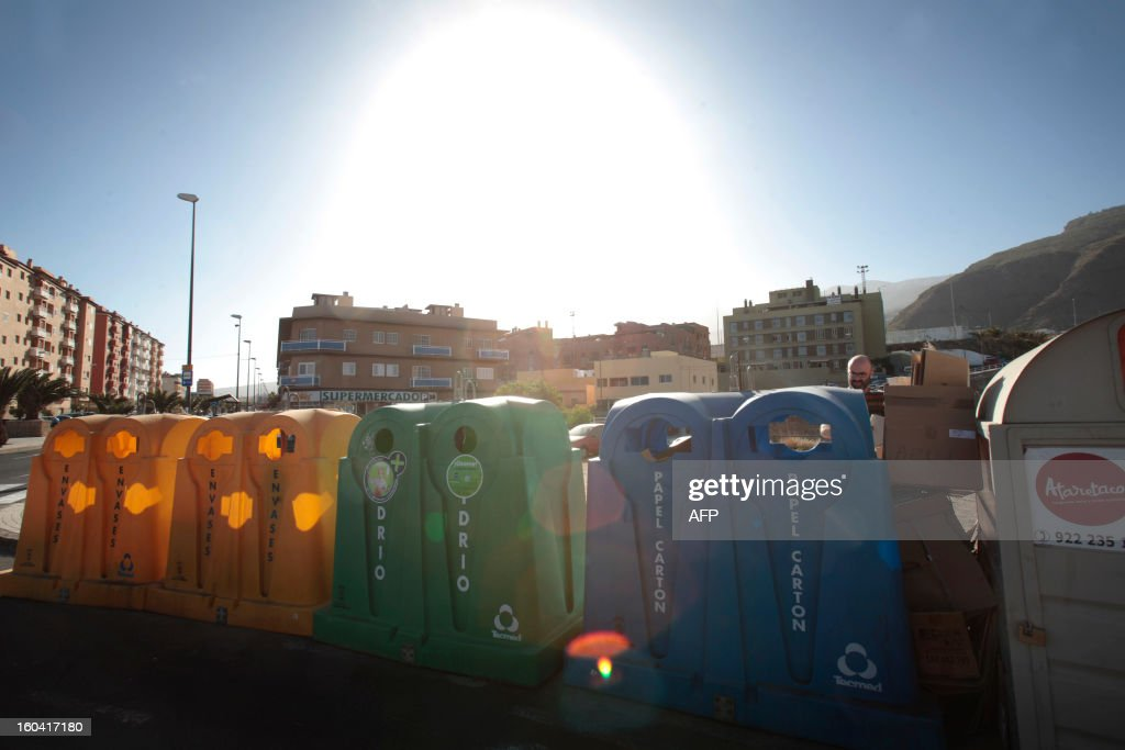 Recycling containers are pictured in Santa Cruz de Tenerife on January 30, 2013 . AFP PHOTO / DESIREE MARTIN