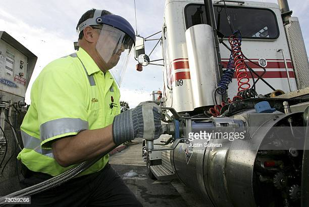 Recycling Disposal Inc employee Arturo Vides prepares to pump liquid natural gas into a trucks tank January 18 2007 in San Francisco California...