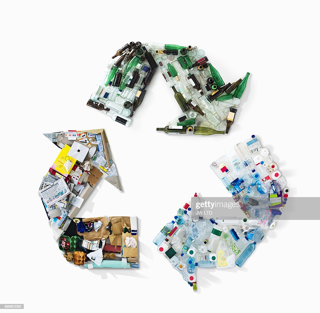 Recycling materials in shape of recycling symbol