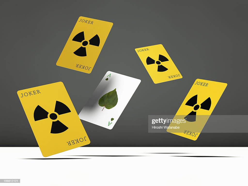 Recycling playing cards in mid-air : Stock Photo