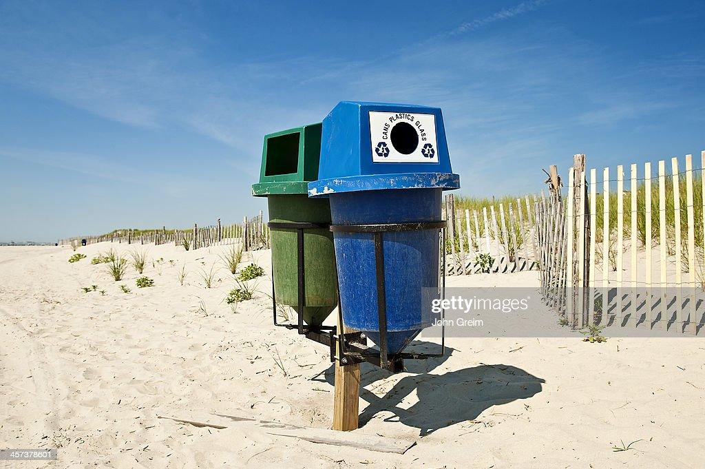 recycling trash bins on the beach