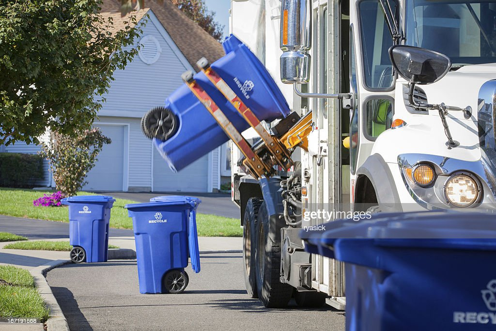 Recycling Truck Lifting Up Container Along Neighborhood Curb : Stock Photo