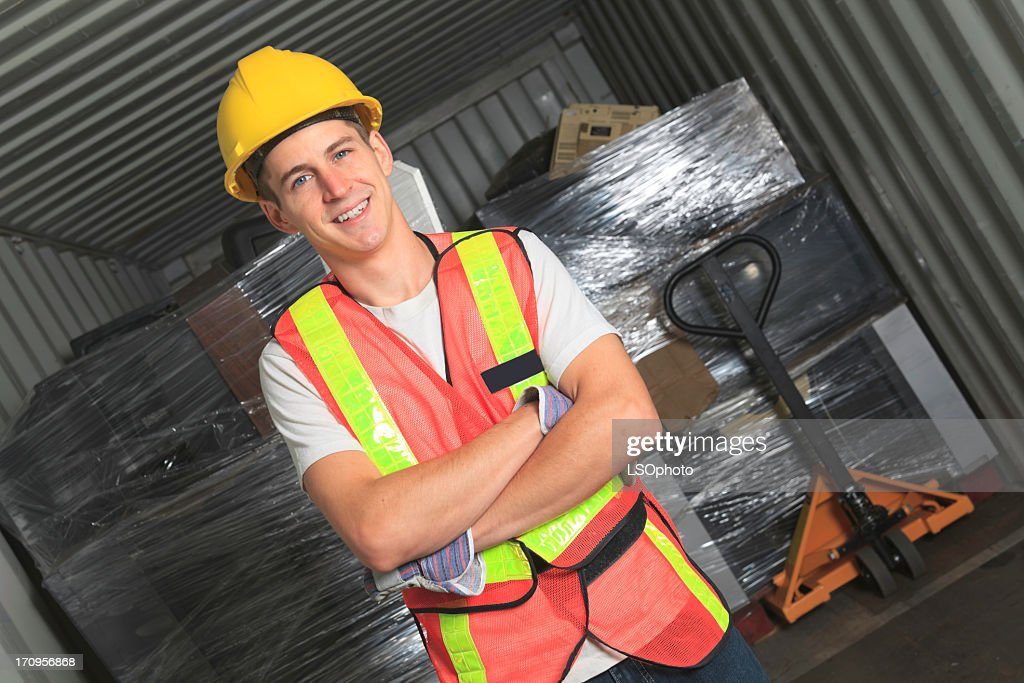 Recycling Worker - Employee TV On Container : Stock Photo