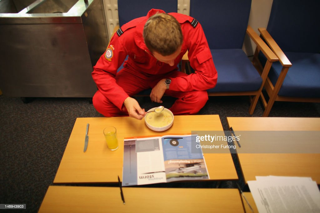 Red 4, Flight Lieutenant James McMillan reads an aviation magazine as he has lunch in the mess of the Red Arrows at RAF Scampton on June 22, 2012 in Scampton, England. The famous Royal Air Force Red Arrows are perfecting their routine for a fly past next week when the Olympic torch arrives in Norfolk and also for an audience of millions during the opening ceremony of the London 2012 Olympics.