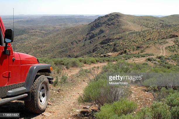A red 4x4 vehicle driving in the Flinders Ranges