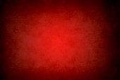 red abstract grunge texture or background with black vignette borders