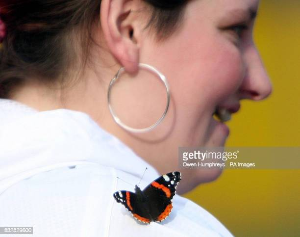 A red admiral butterfly lands on a member of the public in Manchester as the unseasonal temperatures continue PRESS ASSOCIATION Picture date Tuesday...