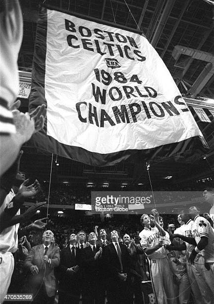 Red Aeurbach joins Larry Bird raising the Boston Celtics 1984 World Championship banner to the rafters