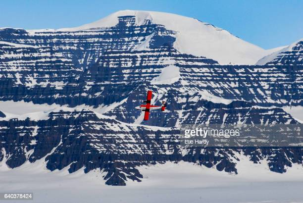 Red airplane landing in Greenland
