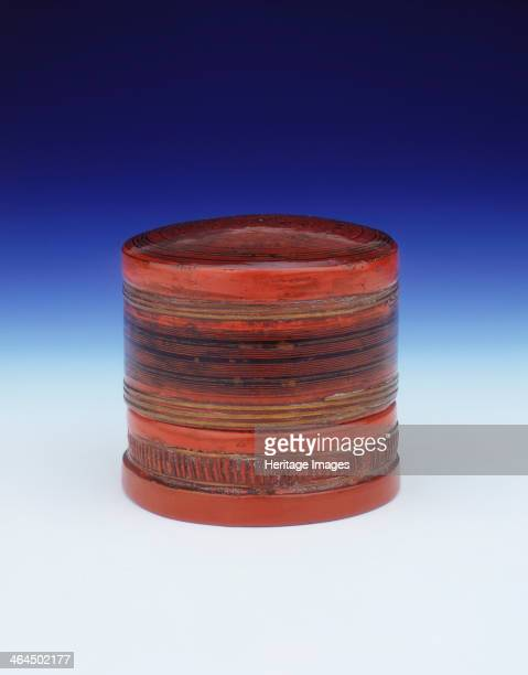 Red and black cylindrical lacquer box Burma Shan states 19th century A tall red lacquer cylindrical box painted in black with various bands of pin...