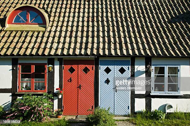 Red and blue doors on village house.