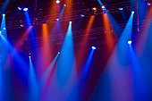 Red and blue lighting attached to a metal row in a concert