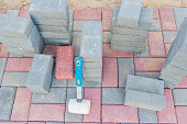 red and gray concrete paving blocks. Road Paving, construction.