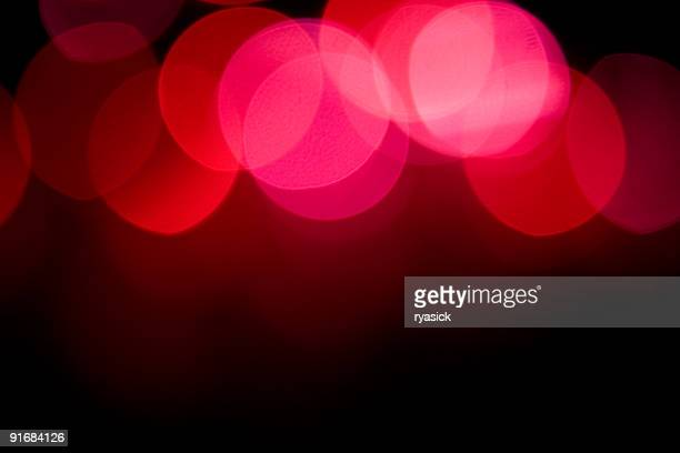 Red and Pink Blurred Bokeh Lights at Top of Background