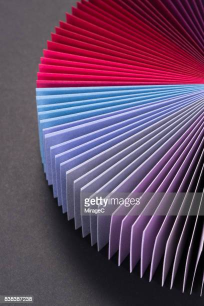 Red and Purple Colored Paper Cards Fan Out Shape