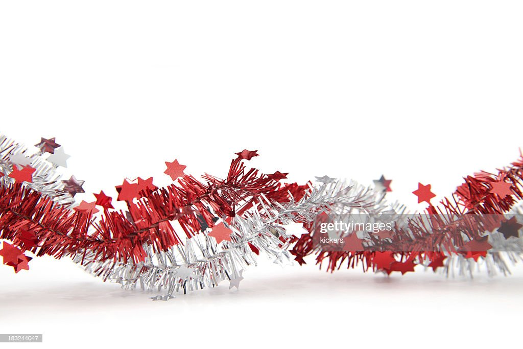 'Red and silver tinsel with stars, isolated'