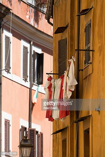 Red and white laundry hanging in Trastevere Rome