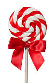 Red and white lollipop with a red bow