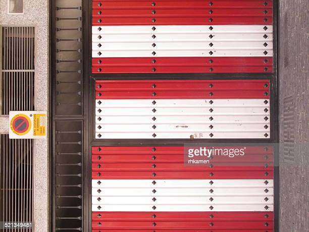 Red and white striped shutters, Granada, Spain