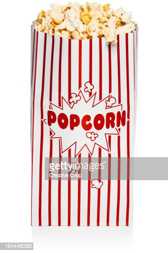 Red and white stripped bag of popcorn : Stock Photo