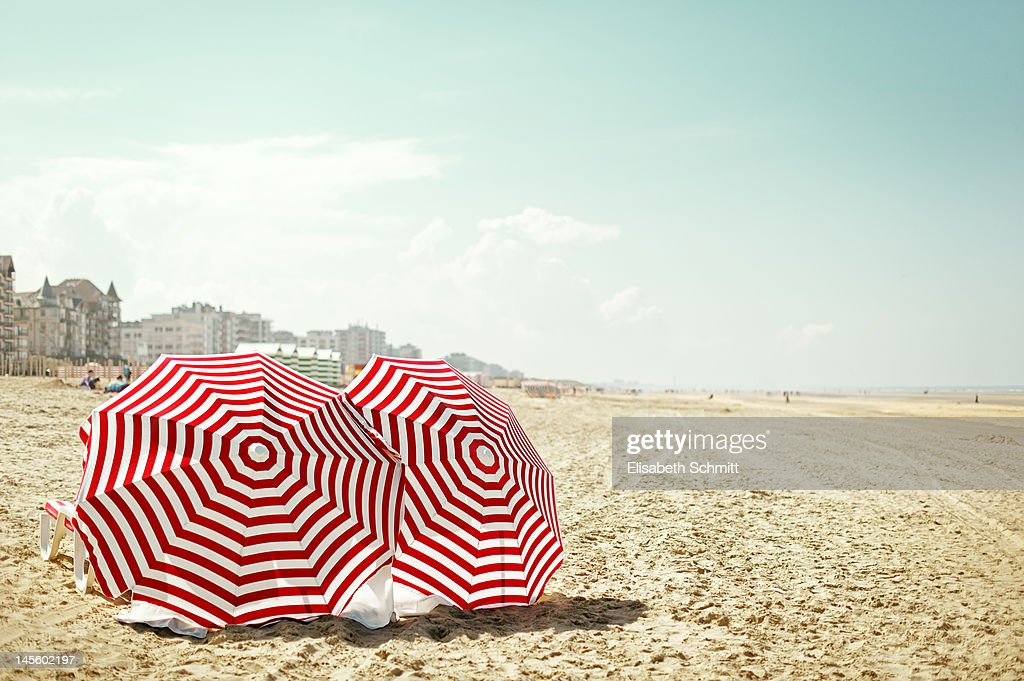 Red and white umbrella at beach : Stock Photo