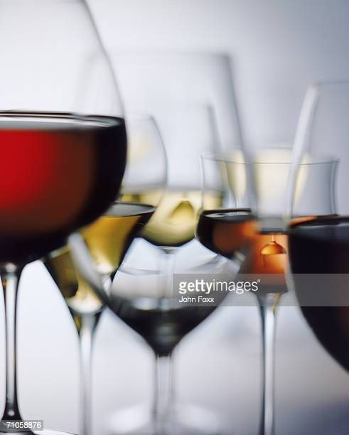 Red and white wine glass on white background, close-up